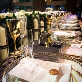 Gold goblets and gold beaded charger plates