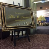 Black and Gold Mirror with Welcome Sign