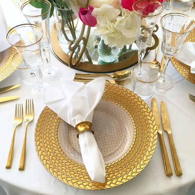 Gold Braided Charger Plates with Gold Cutlery and napkin ring