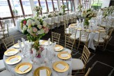 Gold Charger plates and tiffany chairs