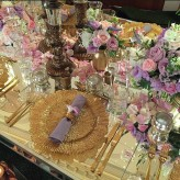 Gold Flare Charger Plates on Lux Mirror table