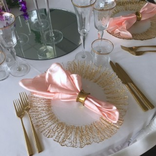 Gold Frost Charger Plate with pink satin napkin