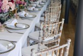 Limewash Tiffany Chairs with beaded charger plates