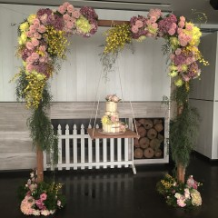 Wooden arch with cake swing