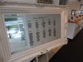 White Ornate seating plan mirror