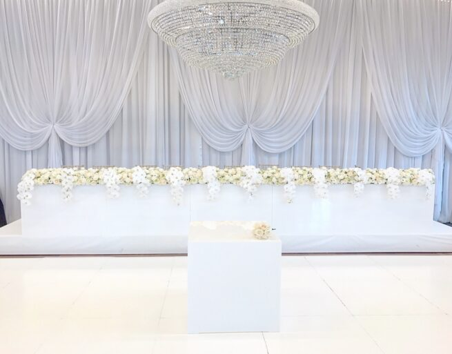 White gloss bridal and cake table