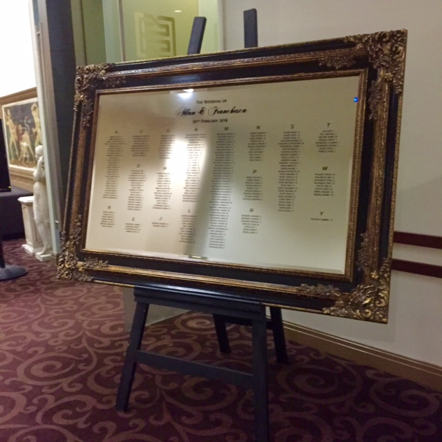 Black and Gold Mirror with Seating Plan