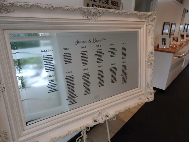 White Ornate seating plan mirror