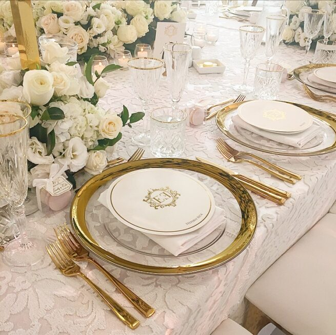 Thick Gold rim charger plates and gold cutlery