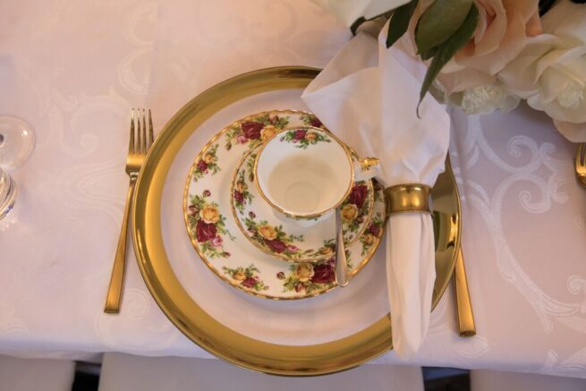 Thick Gold Rim charger and gold napkin ring