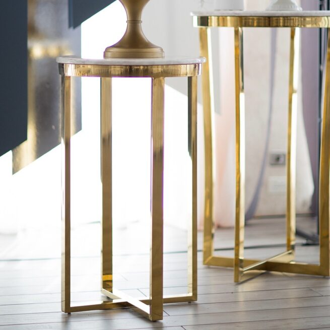 Gold pedestals with marble top