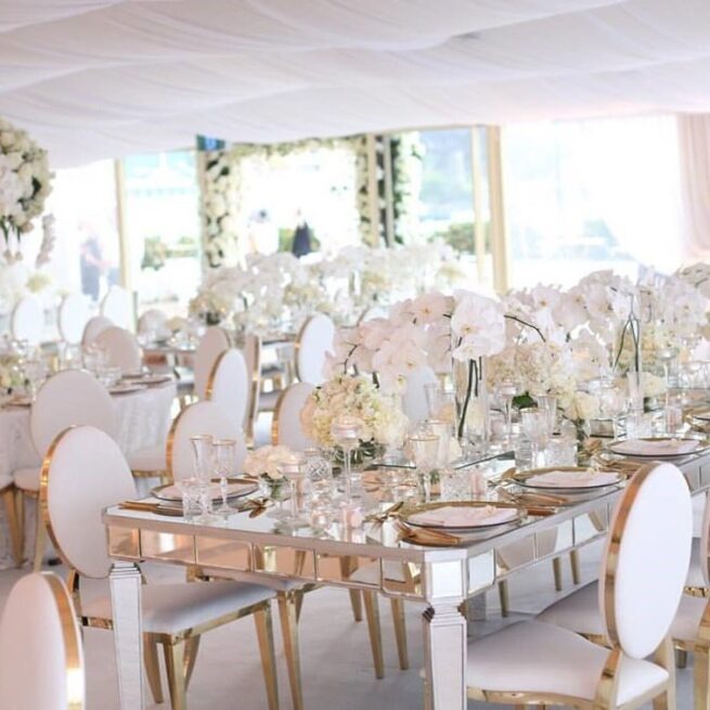 Lux mirror tables with gold round back chairs
